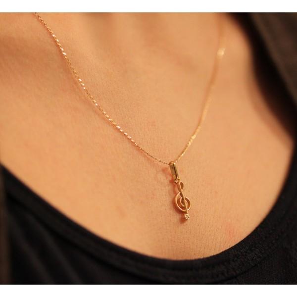 pendentif or clé de sol et diamant