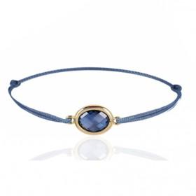 Bracelet cordon ajustable et topaze blue London ovale à facettes