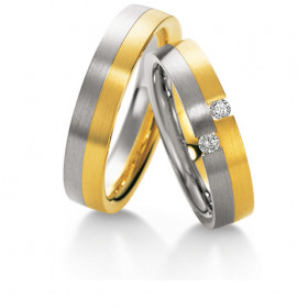 Duo d'alliances Breuning deux ors (or jaune et or blanc) et diamants 0,10 carats