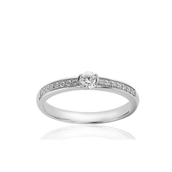 Bague solitaire demi-tour en or blanc 18 carats et diamant 0,40 carat serti rail