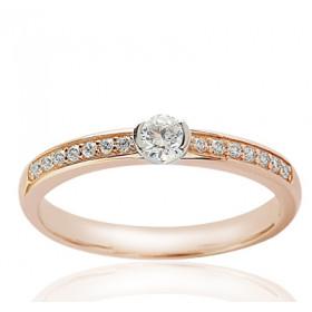 Bague solitaire demi-tour en or jaune 18 carats et diamant 0,40 carat serti rail