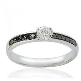 Bague solitaire demi-tour en or blanc 18 carats et diamant 0,48 carat serti rail