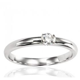 Bague solitaire en or blanc 18 carats et diamant 0,15 carat serti barrettes.