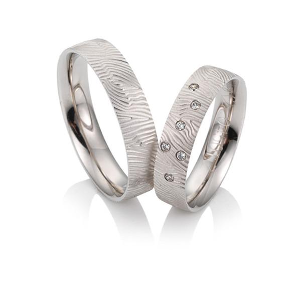 Duo d'alliances breuning or blanc 18 carats et diamants 0,06 carat