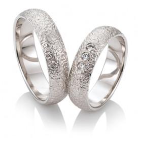 Duo d'alliances breuning or blanc 18 carats et diamants 0,10 carat
